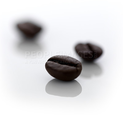 Buy stock photo Closeup image of coffee beans on a shiny surface
