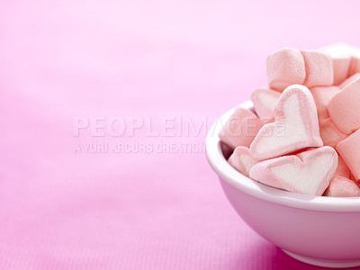 Buy stock photo Bowl full of sweet heart shaped marshmallows on pink background  - Copyspace