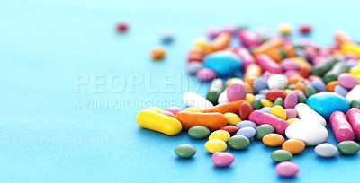 Buy stock photo Many multicolored candy sweets on blue background - Copyspace