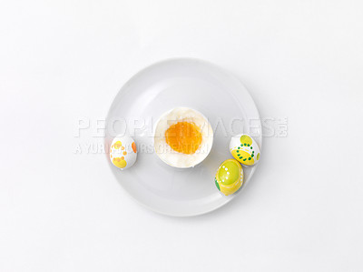 Buy stock photo Small handmade easter eggs with a soft boiled egg in eggcup isolated on white background