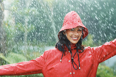 Buy stock photo Happy woman enjoying the rain