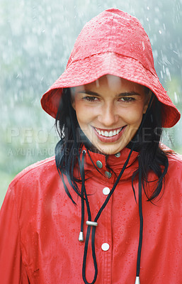 Buy stock photo Pretty woman smiling while standing in rain