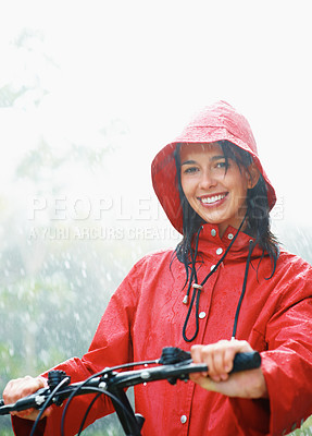 Buy stock photo Woman sitting on bicycle in rain