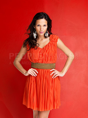 Buy stock photo Portrait of stunning young female fashion model posing against red background