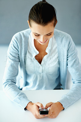 Buy stock photo Top view of woman texting on cell phone