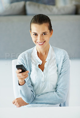 Buy stock photo Woman sitting indoors and holding phone
