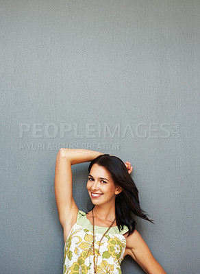 Buy stock photo Flirtatious woman posing and smiling against background
