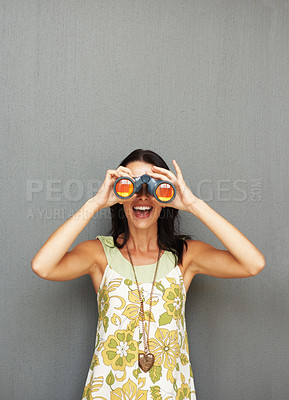Buy stock photo Pretty woman looking through binoculars