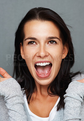 Buy stock photo Pretty woman throwing arms up in surprise