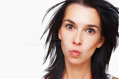 Buy stock photo Pretty woman puckering her mouth against white background
