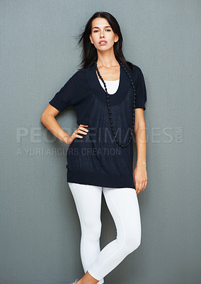 Buy stock photo Pretty woman looking seductive while posing with hand on hip