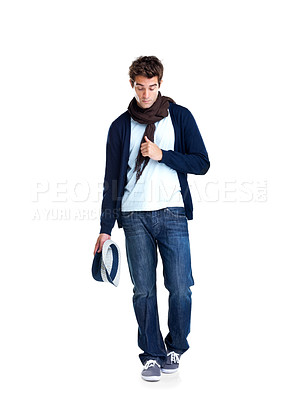 Buy stock photo Stylish young man walking on white background holding a hat