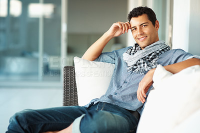 Buy stock photo Portrait of stylish young man relaxing on couch at home