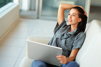 Buy stock photo Portrait of pretty young girl looking away while working on laptop