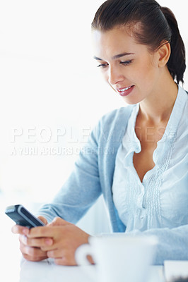 Buy stock photo Portrait of young woman reading text message on cellphone