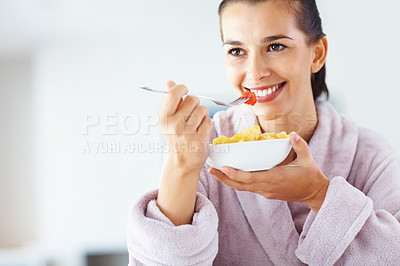 Buy stock photo Closeup portrait of smiling young female eating bowl of fresh fruits
