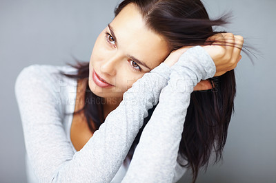 Buy stock photo Thoughtful young woman resting her head on hands