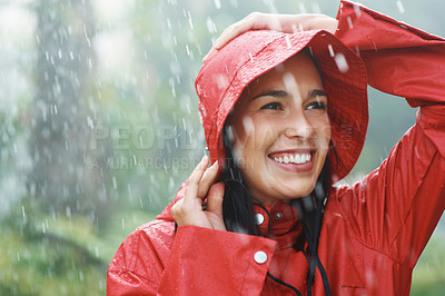 Buy stock photo Woman in red raincoat enjoying rainy weather