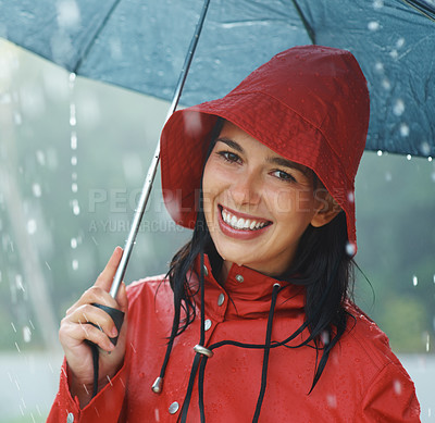 Buy stock photo Closeup portrait of young woman smiling while holding an umbrella