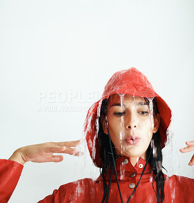 Buy stock photo Closeup of happy young girl in red raincoat getting wet - copyspace
