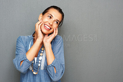 Buy stock photo Attractive young woman holding her face and smiling - copyspace