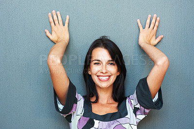 Buy stock photo Portrait of smiling young woman leaning against wall