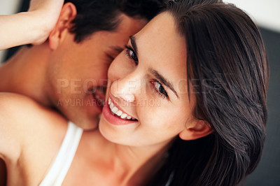 Buy stock photo Closeup of young man kissing his beautiful girlfriend's neck