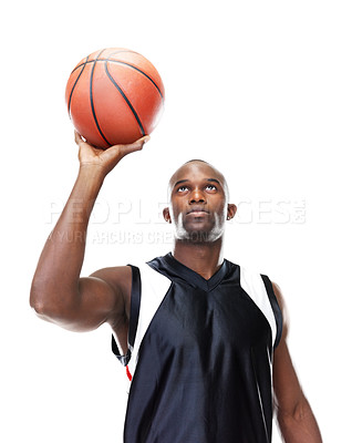Buy stock photo Portrait of a young male basketball player taking free throw against white background