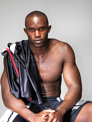 Buy stock photo Portrait of a handsome black male sportman looking with an attitude