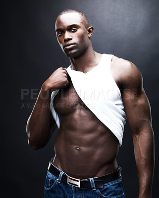 Buy stock photo Portrait of young African American muscular man showing his abs, isolated on grey - copyspace
