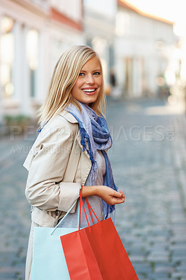 Buy stock photo Urban view of attractive young woman with shopping bags