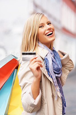 Buy stock photo Beautiful woman holding credit card and shopping bags