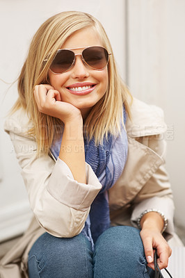 Buy stock photo Beautiful young woman in sunglasses smiling with hand on chin