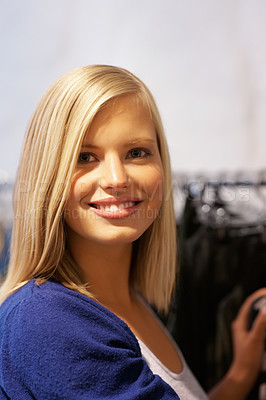 Buy stock photo Closeup portrait of smiling young woman standing in the store