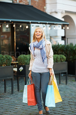 Buy stock photo Full length of pretty young woman with shopping bags