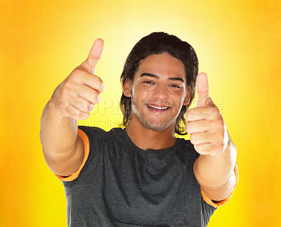 Buy stock photo Handsome man giving two thumbs up