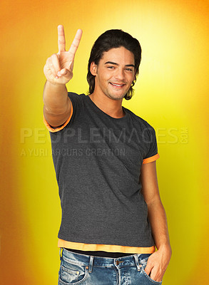Buy stock photo Man giving peace sign against yellow background