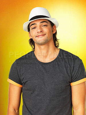 Buy stock photo Handsome man against yellow background wearing hat indoors