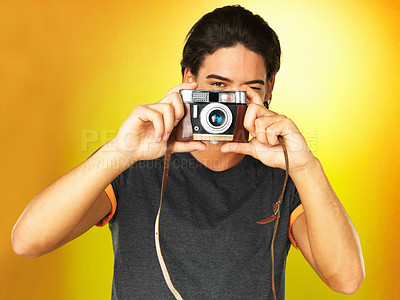 Buy stock photo Man looking through  camera