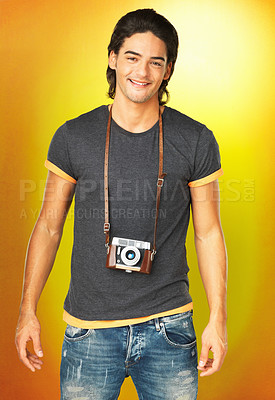Buy stock photo Casual man standing with vintage camera around neck