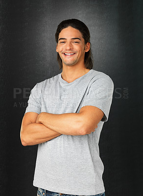 Buy stock photo Handsome man dressed casually with arms folded against gray background