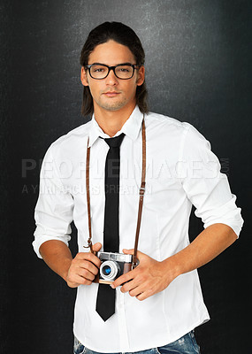 Buy stock photo Portrait of man standing with vintage camera around neck