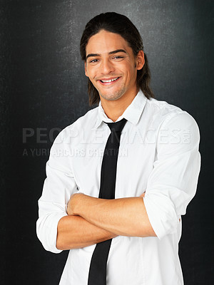 Buy stock photo Attractive man smiling with his arms folded against gray background