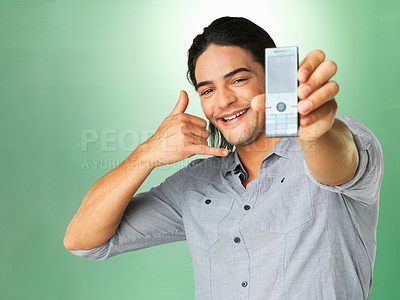 Buy stock photo Man holding cell phone and gesturing to call