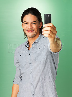 Buy stock photo Handsome man taking photo with his cell phone