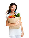 Young female holding a shopping bag full of groceries