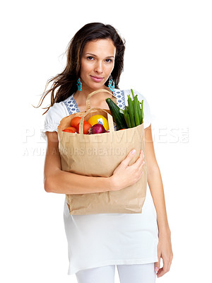 Buy stock photo Portrait of cute young female holding a shopping bag full of groceries on white background