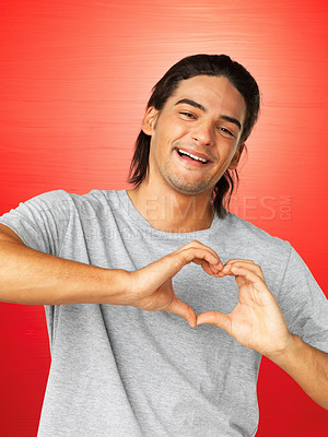 Buy stock photo Portrait of happy man making heart sign