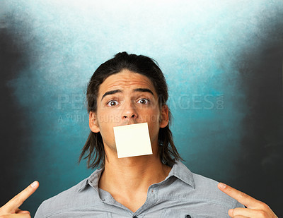 Buy stock photo Portrait of young man with adhesive tape covered on his mouth