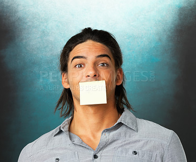 Buy stock photo Handsome man with adhesive note over his mouth